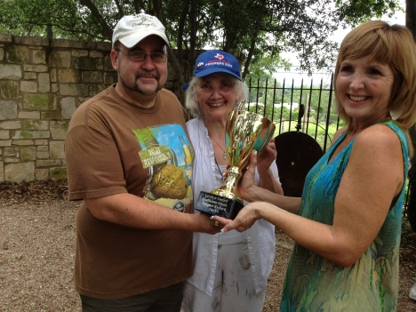 From left to right Jacques,Carolyne and the trophy was presented by Sandy. Congratulation.