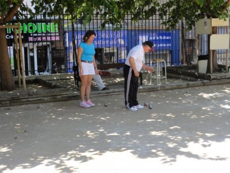 Michelle played her  first petanque game in Marseille with Coco.